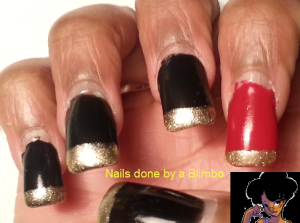 red, black, and gold mani